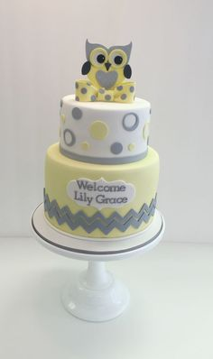 Fondant baby shower cake with yellow and gray to match invitation by Frost It Cakery