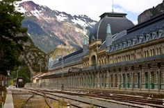 """Is Europe's ghostliest train station about to rise again? When they built the station at Canfranc, it was on a grand scale and with no expense spared. It had to be bold and modern - an architect's dream come true, built in iron and glass, complete with a hospital, restaurant and living quarters for customs officers from both France and Spain. At the time it was nicknamed the """"Titanic of the Mountains"""". To give you an idea of its size - there are 365 windows, one for each day of the year."""