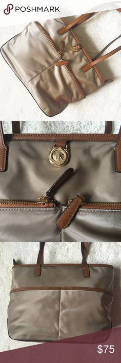 MICHAEL Michael Kors | Kempton tote bag This classic handbag features multiple pockets and lots of stylish details, like leather accents and a bright interior. Like-new: only sign of wear is a very small mark as seen in the last photo. No trades or PayPal. MICHAEL Michael Kors Bags Totes