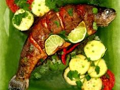 While fresh whole fish is usually grilled outdoors in Thailand, this fish recipe with garlic-chili sauce can be baked and broiled indoors or barbecued outside.