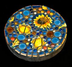 Blue Daisy Stepping Stone:  From a broken serving platter and gems purchased at…