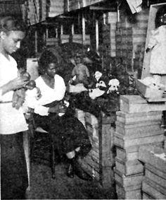A Negro doll factory in Harlem which provides colored dolls for Negro children.