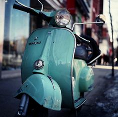 an antique turquoise vespa PLEASE