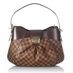 Sophisticated yet playfully patterned, this Louis Vuitton handbag is perfect for any occasion