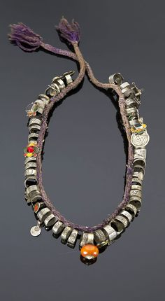 Morocco - Western Anti Atlas, Souss Valley | Necklace; braided wool cord, strung with a collection of silver rings, some with enamel, or stone cabochons | 558€ ~ sold (May '15)