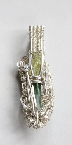 Sterling Silver Wire Wrap Pendant Heady Festival Wrap Zincite Bi-Color Tourmaline. $250.00, via Etsy.