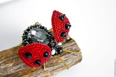 Buy or order Brooch 'ladybug' in online shops on My Livemaster. Gorgeous sparkly brooch in the shape of a ladybug complements any outfit from casual jacket to evening dresses! Will give vivid mood to your style. Brooch made in the technique of dimensional bead embroidery. The body of the bug glass rhinestone oval shape. Rhinestone lined Czech beads and crystal beads. The head of the beetle consists of crystal beads and ceramic pearl, wings are embroidered with crystal beads and Czech ...
