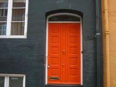 I love the charcoal grey house with dark orange door