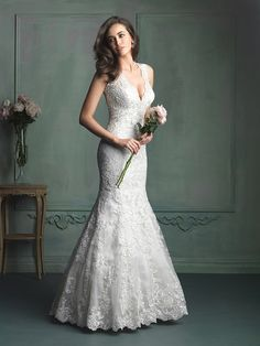 This modern mermaid gown features contour straps, lace and gorgeous crystal beading at the neckline. @allurebridals