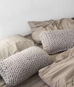 PILLOWS . knitted in natural colors