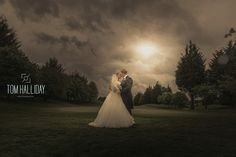 Tom Halliday photography - uk wedding photographer - country wedding - bridal photography - stormy dramatic sky photography - bride portrait - groom portrait - kiss photography - wedding photography