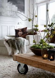 Interesting centerpiece idea.. always like the industrial looking coffee tables also.
