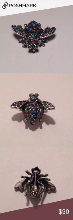 """Joan Rivers Turquoise Cluster bee pin Colorful Joan Rivers Simulated turquoise cluster bee pin. Multicolored simulated crystals and turquoise beads all set in an antiqued silver tone metal. Measures 1"""" long X 1 1/4"""" wide. Marked Joan Rivers Joan Rivers Jewelry Brooches"""