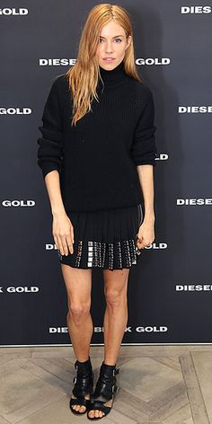 SIENNA MILLER Looking like her typical badass fashionable self, Sienna teams a slouchy black turtleneck with a pleated, mirror-adorned mini and buckled sandals for a cocktail party celebrating the Deisel Black Gold flagship store in London.