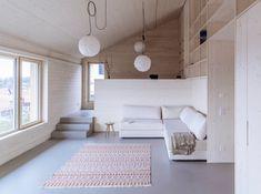 Holz und Beton - 4architekten  | Neubau eines Einfamilienhauses mit halb in den Hang eingegrabenem Sockelgeschoss, welches die Schlafräume beherbergt...