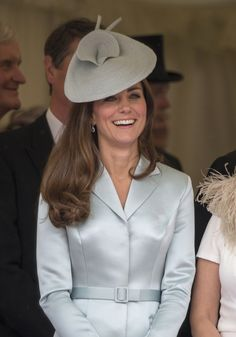 It's clear the Duchess likes to wear the same color from head to toe. Here, she pairs an ice blue Lock & Co. hat with a similar-colored coat dress to attend the Most Noble Order of the Garter ceremony on June 16, 2014.  - GoodHousekeeping.com