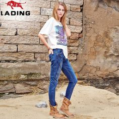 The new micro-breaking fashion personality trousers Slim thin female waist jeans asymmetries