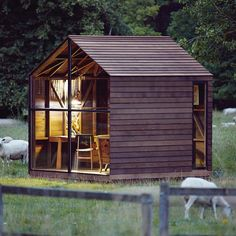 """Nathalie De Leval, Paul's Shed by AHEC. Designed for the exhibition """"The Wish List"""" at the Victoria & Albert Museum, Paul's Shed is a wooden hut designed as a place for relaxation. The structure is made from dark-coloured, thermo-treated American ash that is resistant to rot"""