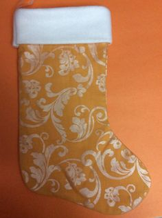 A personal favorite from my Etsy shop https://www.etsy.com/listing/252925305/handmade-christmas-stocking-orange-and