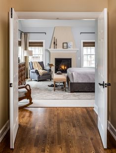 I love the coziness the fireplace adds to this master suite addition. Click the image to view more of our projects! Master Bedroom Addition, Master Bedroom Design, House Yard, Fireplace Design, Interior Design Inspiration, French Doors, Fields, Lavender, Bedrooms