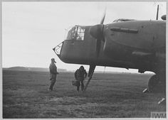 Original wartime caption: Silhouette at dusk - the crew are taking up their positions in the aircraft. Royal Air Force, Dusk, Caption, Aircraft, England, Silhouette, Aviation, Captions, Planes
