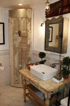 """Farmhouse chic"" bathroom  Love the sink, medicine cabinet and the old door in corner. love it all"