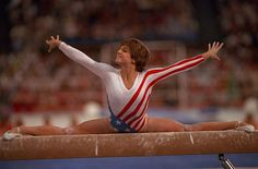 USA's Mary Lou Retton does a split on the beam during the 1984 Summer Olympics. Retton would go onto win five medals, including one gold, during the '84 games. (Andy Hayt/SI)  GALLERY: SI's Best Summer Olympic Covers #EasyPin