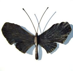 Metal Butterflies...garden ornaments...need to try to make some this summer