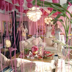 The following photos are from Betsey's perfume launch held in her own apartment… Love those pink helium balloons with their tails creating an impermanent curtain.