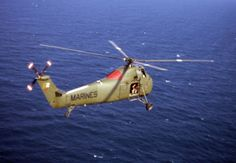 US Marine Corps Sikorsky Chocktaw (also licence built in UK by Westland as Westland Wessex) of Marine Medium Helicopter Squadron (HMM) 363 over South China Sea. The red paint pattern on aircraft's top was unique to squadron, enabling easier identification. Pictured during Vietnam War era.