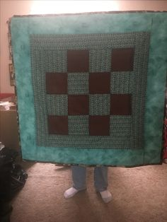 My grandson Owen received this quilt for Christmas 2016. Basic checker board style using layer cake and only 3 prints