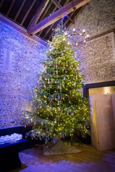 Giant 24ft Christmas Tree in The Granary Barn, decorated by #tollysflowers #winterwonderland #christmasparty #christmastree #christmasdecoration #petedennessphotography
