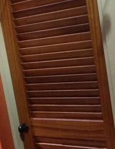 Custom, plantation style louvered door in Sapele Mahogany.