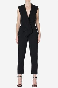 A classic black crepe jumpsuit is given a feminine twist with plunging sultry neckline. Description from coolspotters.com. I searched for this on bing.com/images