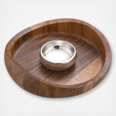 Inspired by a butterfly in flight, this set establishes a strikingly contemporary tone. Measuring 16 inches in diameter the warm acacia-wood chip tray features a swooping rim rising to 4.5 inches high. Naturally resinous, acacia will not absorb stains or odors. The tray is accompanied by a 5.5-inch-diameter metal bowl for dip, The dip bowl has a silver-like luster in contrast to the tray's warm tones. Made of Nambe Alloy, the signature tarnish-resistant metal, the dip bowl is durable and…