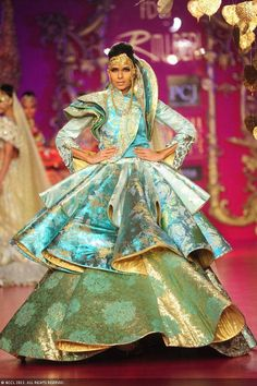 Candice Pinto showcases a creation by designer Ritu Beri on Day 4 of Delhi Couture Week, held in New Delhi, on August 03, 2013.