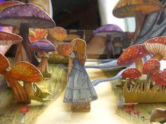 Alice paper cutouts