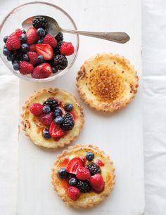 Buttermilk Tartlets with Fresh Berries; don't over fill the shells, the custard will bubble up and overflow in the oven. Very quick to make if using store-bought pie crust. Love!