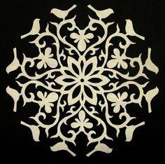 La colcha de la Rata: Corte de los copos de nieve de papel