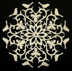 Cutting Paper Snowflakes - easy instructions (can also make your own designs)