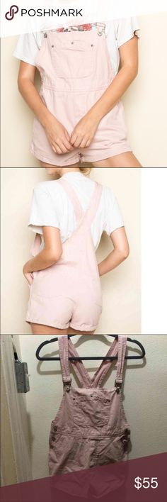"""Brandy Melville Blush Pink Olwen Shorts Overalls -Worn once by previous owner -Size S -28"""" in length, 12"""" bust, 16"""" waist, 11"""" rise, 2"""" inseam. -Model is 5""""8 with a 24"""" waist!  Super cute Brandy Melville Blush Pink Olwen/Alia Shorts Overalls. Feautures adjustable straps, cuffed hems, side and back pockets, and cross back straps.   No flaws at all, perfect condition. Price is firm, only cheaper via 🅿️🅿️ or Ⓜ️erc.  Will take better pictures tomorrow. Brandy Melville Jeans Overalls"""