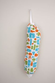Great idea for easily recycling plastic produce bags!  I'd even make a mini one to use for doggie-doo bags too! Just attach it to our leashes.     ( credit: Jessica Christian [http://www.craftinessisnotoptional.com/2011/05/20-minute-grocery-bag-holder-tutorial.html])