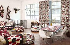 http://www.gopret.com/wp-content/uploads/2014/10/glamorous-living-room-design-with-floral-pattern-curtain-in-glass-window-as-well-colorful-floral-pillow-and-red-circle-pattern-dining-table-the-top-featuring-white-chair.jpg
