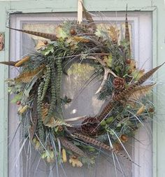 Wreath: pheasant feathers and deer antler sheds.