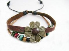 Leather bracelet with bronze metal flower.