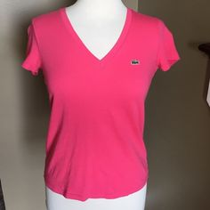 Lacoste pink Top! Lacoste pink V neck top! Great condition! Green alligator on the front. Authentic Lacoste! 100% cotton! Lacoste Tops Tees - Short Sleeve