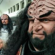 """Klingons are one of the iconic alien races in the """"Star Trek"""" franchise. Their appearance has been set firmly since """"The Next Generation,"""" with pronounced forehead and nose ridges, deep-set eyes and long hair. There are many generic Klingon masks available, but they usually have hair that is sculpted in place and a generic expression. You can..."""