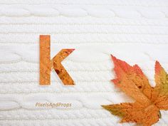 Lowercase letter k with glitter leaf and sweater knit. #fall #autumn #alphabet #typography #initial #monogram #font   maple leaf