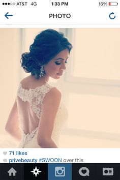 Messy bun bride all up wedding hair ideas bridal looks perfect smokey eye gorgeous wedding pose white lace back pretty soft elegant photo photography weddings Privé beauty group pinned up loose curls keyhole drop pretty long sparkly earrings must have