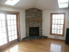 Interior : Excellent corner stone fireplace design ideas for natural home decoration with river rock brick and golden honey window picture - a part of Amazing Makeover Stone Fireplace Design Ideas For Delightful Living Room Blueprint